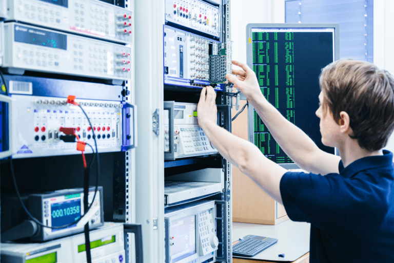 Calibration engineer performing a calibration according to ISO-17025 on DAQ systems from DEWETRON.